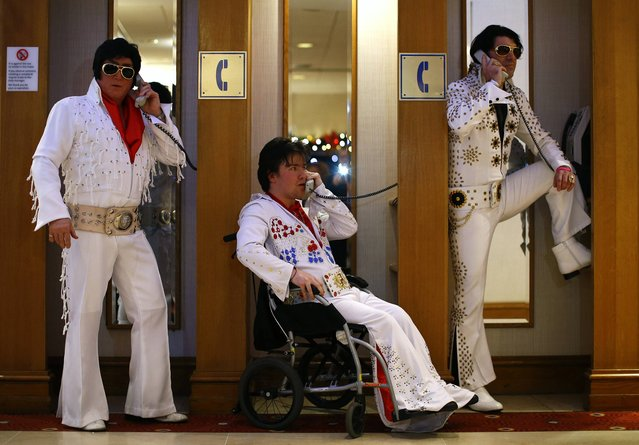 Amateur contestants (L-R) Phil Bailey, John Hindle and Eren Emir pose in telephone booths during the annual European Elvis Tribute Artist Contest and Convention in Birmingham, central England January 2, 2015. (Photo by Darren Staples/Reuters)