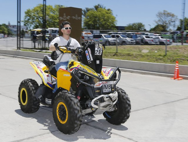 Christian Pinto Cajica of Colombia powers his Can-Am quad to the technical verification area ahead of the Dakar Rally 2015 in Buenos Aires January 2, 2015. (Photo by Enrique Marcarian/Reuters)