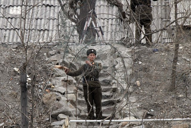 A soldier stands guard at a sentry post, at the banks of Yalu River, near the North Korean town of Sinuiju, opposite the Chinese border city of Dandong, March 30, 2013. (Photo by Jacky Chen/Reuters)