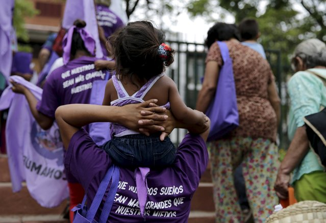 """Women from different social, rural and urban organizations march to commemorate International Day for the Elimination of Violence Against Women in Asuncion, November 25, 2015. The words on the t-shirt say """"That our dreams are bigger than our fears"""". (Photo by Jorge Adorno/Reuters)"""