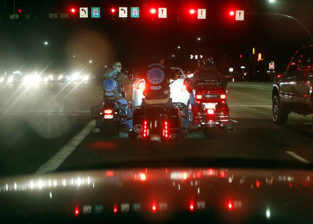 Members of the Idaho Three Percent ride motorcycles after a meeting in Meridian, Idaho, U.S. April 7, 2016. (Photo by Jim Urquhart/Reuters)