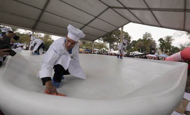 Workers preparations to cook Koshary, a popular Egyptian dish, in an attempt to break the Guinness World Record for the world's biggest plate of Koshary, at a general garden in Zamalek, Cairo, January 17, 2015. (Photo by Mohamed Abd El Ghany/Reuters)