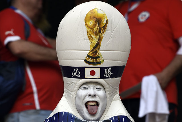 A disguised Japanese fan sticks out his tongue before the Russia 2018 World Cup Group H football match between Colombia and Japan at the Mordovia Arena in Saransk on June 19, 2018. (Photo by Juan Barreto/AFP Photo)