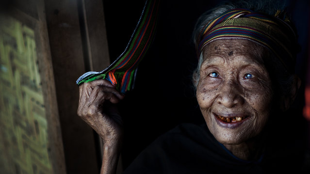 """Old Smile"". One of the crafts which Lombok is famous for is textile weaving. This old lady was shot at the the small, traditional village that produces these unique and beautiful craftsmanship. Lombok, Indonesia. (Photo and caption by Rio Murti/National Geographic Traveler Photo Contest)"