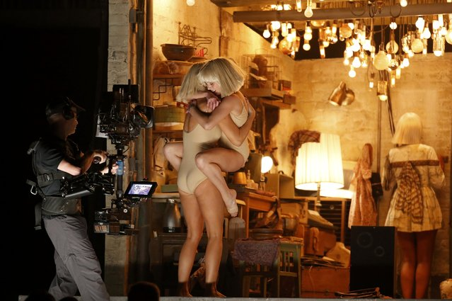 "Kristen Wiig (2nd L) and Maddie Ziegler (2nd R) dance to Sia's ""Chandelier"" as the artist (R) stands with her back to the audience while performing at the 57th annual Grammy Awards in Los Angeles, California, February 8, 2015. (Photo by Lucy Nicholson/Reuters)"