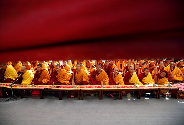 Buddhist monks perform prayers to purify the Boudhanath stupa ahead of its opening on November 22, after it was renovated following last year's earthquake in Kathmandu, Nepal November 18, 2016. (Photo by Navesh Chitrakar/Reuters)