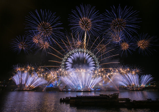 """Unicef wishes London a #HappyBlueYear by adding a hint of blue to the iconic New Year's Eve firework display to support their """"New Year's Resolutions for Children"""" campaign on December 31, 2015 in London, England. (Photo by John Phillips/Getty Images for Unicef)"""