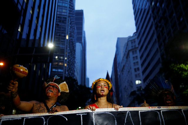 Indigenous people attend a demonstration against a constitutional amendment, known as PEC 55, that limits public spending, in Rio de Janeiro, Brazil November 25, 2016. (Photo by Rodrigo Garrido/Reuters)