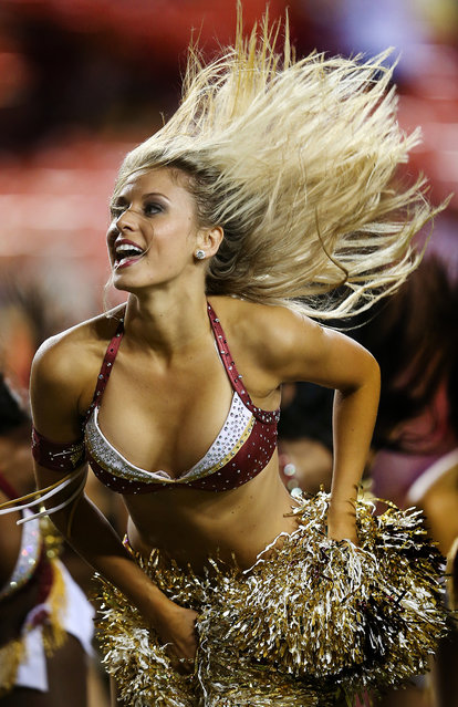 A Washington Redskins cheerleader preforms during a preseason game between the Redskins and Pittsburgh Steelers at FedExField in Landover, Md. (Photo by Rob Carr/Getty Images)