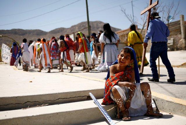 An indigenous Raramuri boy participates in Good Friday celebrations in the Tarahumara neighborhood of Ciudad Juarez, Mexico on April 2, 2021. (Photo by Jose Luis Gonzalez/Reuters)