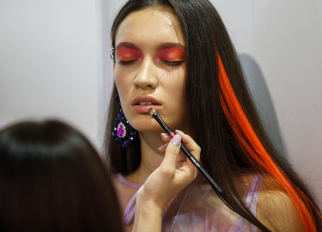 A model gets her makeup done backstage during the Ukrainian Fashion Week in Kiev, Ukraine, 01 September 2018. (Photo by Sergey Dolzhenko/EPA/EFE)