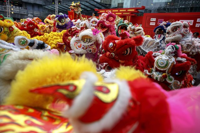 Lion and dragon dancers perform as part of the festive Chinese New Year celebrations in Bangkok's shopping district February 18, 2015. (Photo by Athit Perawongmetha/Reuters)