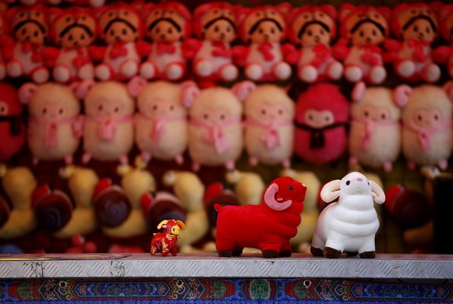 Toys are displayed at a vendor's shop at Ditan Park, also known as the Temple of Earth, in Beijing, February 16, 2015. (Photo by Kim Kyung-Hoon/Reuters)