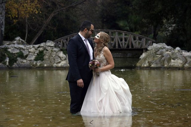 Despoina Symeonidou, 29, and Vasilis Markou, 39, are photographed after their wedding at the national garden in Athens, February 22, 2015. Greek Prime Minister Alexis Tsipras declared victory on Saturday after agreeing a last-minute conditional financial rescue deal with Europe, despite making big concessions to avert financial collapse within days. (Photo by Kostas Tsironis/Reuters)