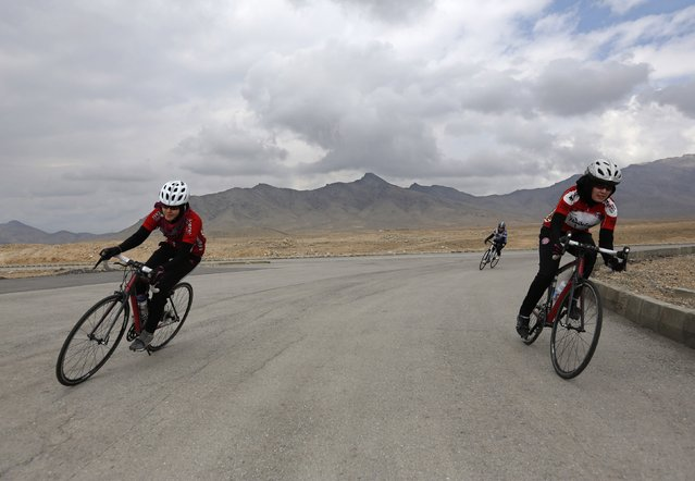 Masooma Alizada (L), and Zahra Alizada (R), member of Afghanistan's Women's National Cycling Team exercise on the outskirts of Kabul February 20, 2015. (Photo by Mohammad Ismail/Reuters)