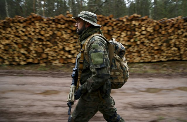 Robert Przybyl takes part in an endurance march during a territorial defence training organised by paramilitary group SJS Strzelec (Shooters Association) in the forest near Minsk Mazowiecki, eastern Poland March 14, 2014. (Photo by Kacper Pempel/Reuters)