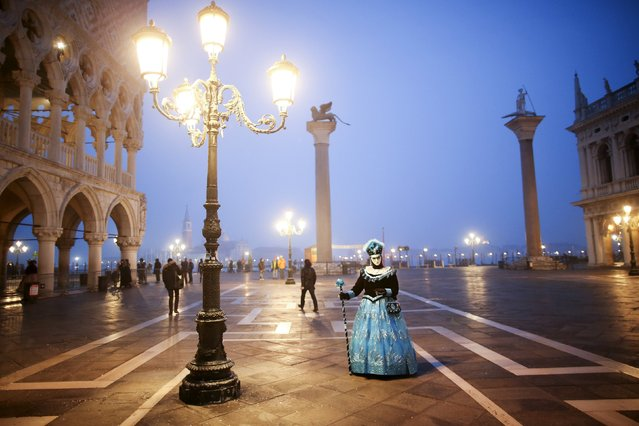 A masked reveller poses during the Venice Carnival, in Piazza San Marco January 30, 2016. (Photo by Alessandro Bianchi/Reuters)