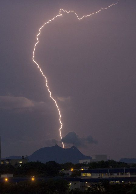 Lightning strikes during a heavy rain storm in Sao Paulo, Brazil, Monday, January 26, 2015. (Photo by Andre Penner/AP Photo)