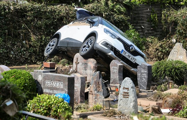 A car is pictured at a cemetary following heavy rainfalls in Dernau, Germany, July 17, 2021. (Photo by Wolfgang Rattay/Reuters)