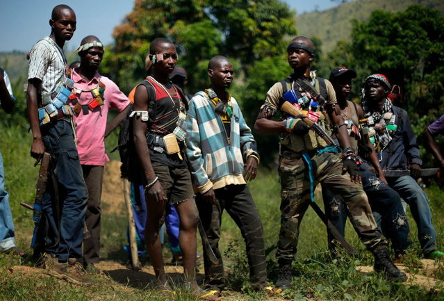 Anti-Balaka Christian militiamen gather in a forest clearing outside Central African Republic's capital Bangui, Sunday December 15, 2013. (Photo by Jerome Delay/AP Photo)