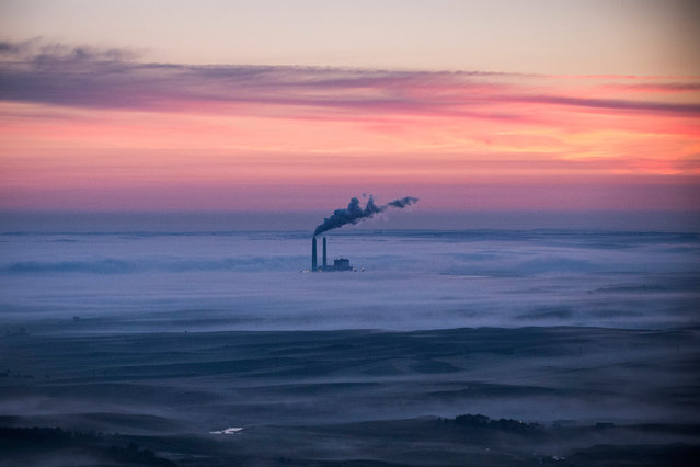 A coal-burning energy plant is seen in an aerial view in the early morning hours of July 30, 2013 near Bismarck, North Dakota. (Photo by Andrew Burton/Getty Images)