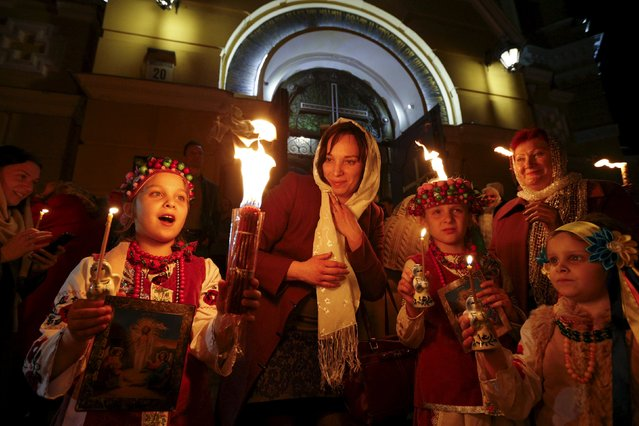 Believers hold candles during the Holy Fire ceremony on the eve of Orthodox Easter service in front of Volodymysky Cathedral in Kiev April 11, 2015. (Photo by Valentyn Ogirenko/Reuters)