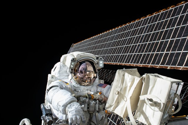 NASA astronaut Scott Kelly is seen while working outside of the International Space Station during a spacewalk on November 6, 2015. Kelly and fellow NASA astronaut Kjell Lindgren restored the port truss (P6) ammonia cooling system to its original configuration and returned ammonia to the desired levels in both the prime and back-up systems. The spacewalk lasted for seven hours and 48 minutes. (Photo by NASA)