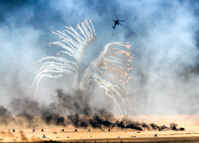 A Kuwaiti military helicopter takes part in a live ammunition military exercise at Udaira military range, 140 km north of Kuwait City, on January 17, 2017. (Photo by Yasser Al-Zayyat/AFP Photo)