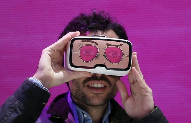 """A man tests the """"Zeiss VR One"""" virtual reality glasses during the Mobile World Congress in Barcelona, Spain February 25, 2016. (Photo by Albert Gea/Reuters)"""