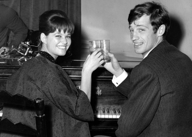 In this November 3, 1960 file photo, French actor Jean-Paul Belmondo and Italian actress Claudia Cardinale attend a cocktail party in the Foreign Press Association in Rome. French New Wave actor Jean-Paul Belmondo has died, according to his lawyer's office on Monday Sept. 6, 2021. (Photo by Mario Torrisi/AP Photo/File)