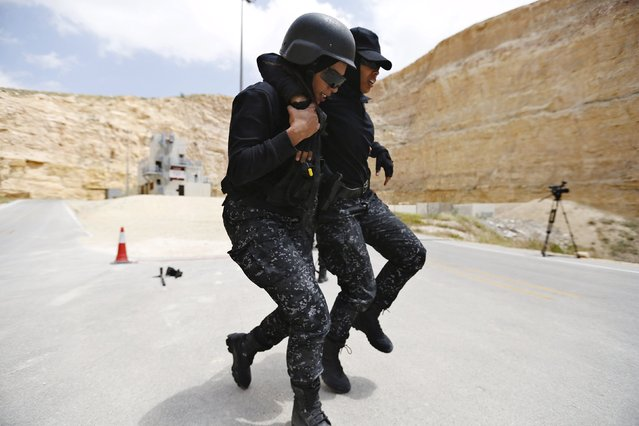 Members of the Jordanian police women's team compete in the 7th Annual Warrior Competition at the King Abdullah Special Operations Training Center in Amman April 22, 2015. (Photo by Muhammad Hamed/Reuters)