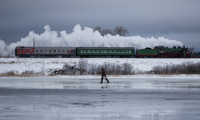 A steam train passes by along a dam outside Ostashkov in Tver region, Russia on February 16, 2019. (Photo by Maxim Shemetov/Reuters)