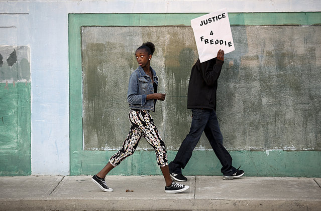 Protestors walk toward Baltimore Police Department's Western District police station during a march and vigil over the death of Freddie Gray, April 21, 2015 in Baltimore, Maryland.  Gray, 25, died from spinal injuries on April 19, one week after being taken into police custody. (Photo by Drew Angerer/Getty Images)