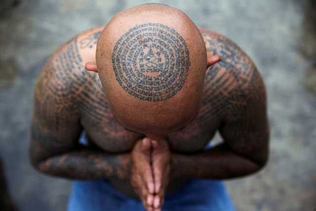 A devotee attends the religious tattoo festival at Wat Bang Phra Monastery, where devotees believe that their tattoos have mystical powers, in Nakhon Pathom province, Thailand, March 16, 2019. (Photo by Athit Perawongmetha/Reuters)