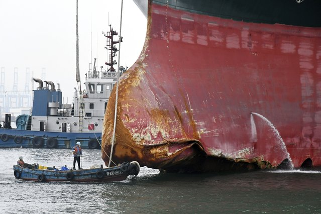 This October 4, 2021 aerial photo released by Xinhua News Agency, shows a view of the damaged part of the Ever Given container ship berthed at a ship-repairing dock of Qingdao Beihai Shipbuilding Heavy Industry Co., Ltd. in Qingdao in eastern China's Shandong Province. The massive Panama-flagged Ever Given had ran aground in March 2021 in the single-lane stretch of the Suez Canal, blocking the canal for six days before being released in a massive salvage effort by a flotilla of tugboats. (Photo by Li Ziheng/Xinhua via AP Photo)