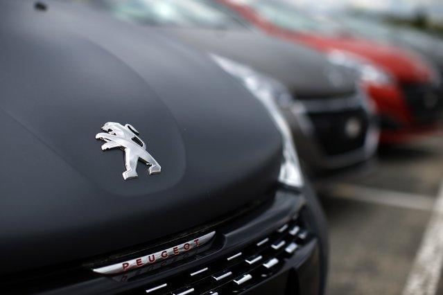Peugeot 208 cars are parked at the PSA Peugeot Citroen plant in Poissy, near Paris, France, April 29, 2015. (Photo by Benoit Tessier/Reuters)