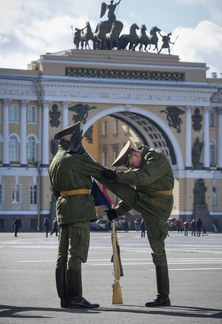 Russian honour guard soldiers warm up prior to a rehearsal for the Victory Day military parade which will take place at Dvortsovaya (Palace) Square on May 9 to celebrate 70 years after the victory in WWII, in St.Petersburg, Russia, Thursday, April 30, 2015. (Photo by Dmitry Lovetsky/AP Photo)