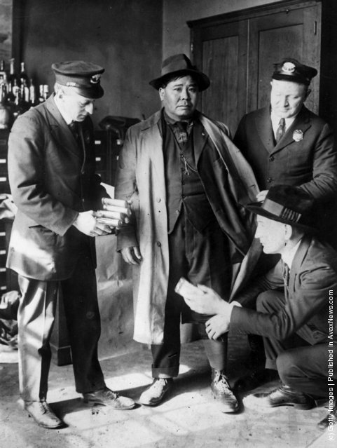 A Chinese seaman being arrested at the port of New York for the attempted smuggling of opium, 1926