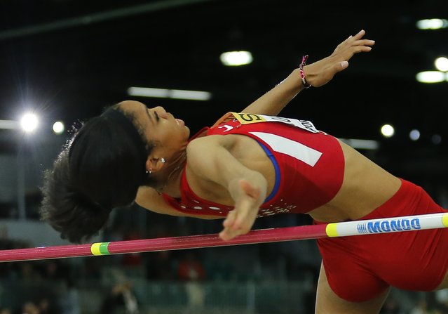 Vashti Cunningham of the U.S. clear the bar on the way to winning the women's high jump gold medal during the IAAF World Indoor Athletics Championships in Portland, Oregon March 20, 2016. (Photo by Mike Blake/Reuters)