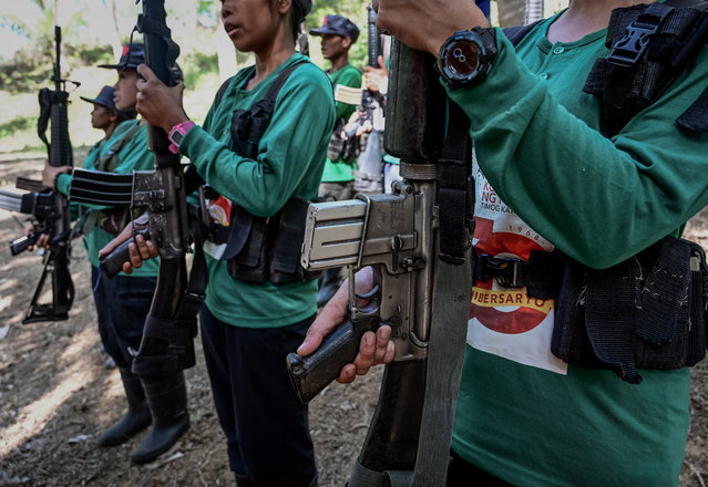 Women fighters of the New People's Army-Melito Glor Command (NPA-MGC) conduct a drill during their 50th founding anniversary celebration at an undisclosed location in the mountains of Sierra Madre, Philippines, 31 March 2019. The NPA launched its rebellion to create a Maoist state in 1969, emerging out of the global communist movement and finding fertile ground in the impoverished country. Its stronghold is in the south but the movement also has a scattered presence in the central Philippines and a few areas in the north. (Photo by Alecs Ongcal/EPA/EFE)