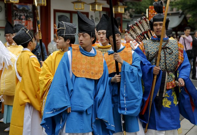 Shinto studies specialty students in traditional costumes gather before a ritual for the Kanda festival at the Kanda-Myojin shrine in Tokyo May 9, 2015. (Photo by Toru Hanai/Reuters)