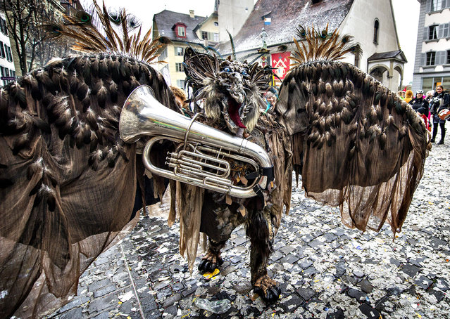 A reveler in a carnival costume attends the opening of the Lucerne carnival in Lucerne, Switzerland, on the so-called dirty Thursday, February 27, 2014. (Photo by Sigi Tischler/AP Photo/Keystone)