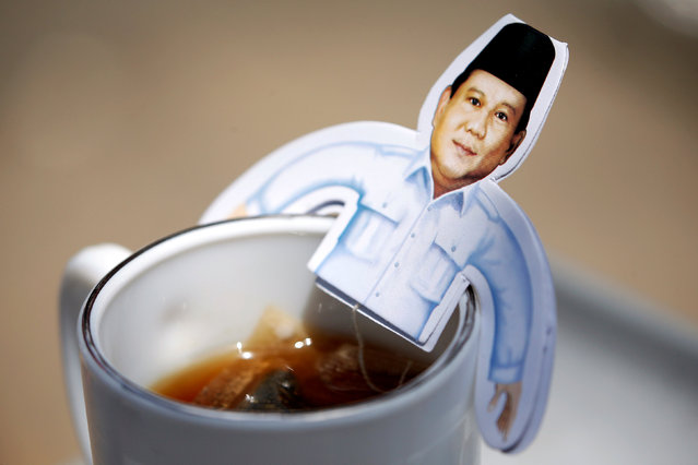 Picture of Indonesia's presidential candidate Prabowo Subianto, who was a former general of the Indonesian military, is seen on a cup during a campaign rally in Solo, Central Java Province, Indonesia, April 10, 2019. (Photo by Willy Kurniawan/Reuters)