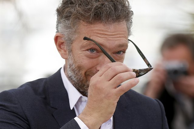 "Cast member Vincent Cassel removes his sunglasses as he poses during a photocall for the film ""Tale of Tales"" in competition at the 68th Cannes Film Festival in Cannes, southern France, May 14, 2015. (Photo by Benoit Tessier/Reuters)"