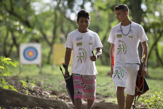 Kambeba Indian, Dream Braga, 18, walks with his friend Nelson Varge da Silva at a training centre in Manaus, Amazon state May 7, 2015. (Photo by Bruno Kelly/Reuters)