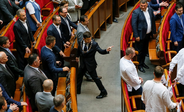 Ukraine's new president Volodymyr Zelenskiy gestures as he walks after taking the oath of office during his inauguration ceremony in the parliament hall in Kiev, Ukraine on May 20, 2019. (Photo by Valentyn Ogirenko/Reuters)
