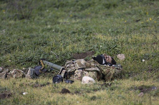 The body of an Azerbaijani soldier lies at a frontline in Nagorno-Karabakh, Azerbaijan, Wednesday, April 6, 2016. (Photo by Karo Sahakyan/PAN Photo via AP Photo)