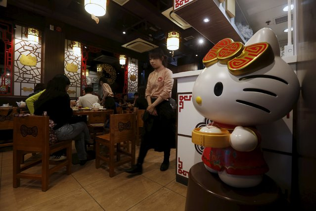 A Hello Kitty statue is displayed at a Hello Kitty-themed Chinese restaurant in Hong Kong, China May 21, 2015. (Photo by Bobby Yip/Reuters)