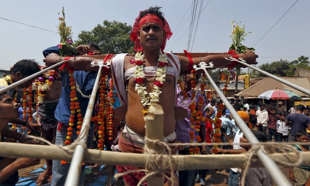 A Hindu devotee is seen nailed to a cross during the annual Shiva Gajan religious festival in Batanal village in West Bengal, India, April 13, 2016. (Photo by Rupak De Chowdhuri/Reuters)