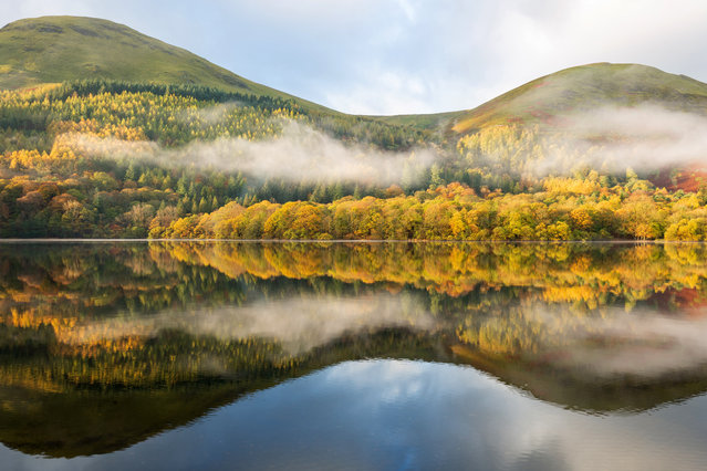 Beautiful autumn colour and low cloud is reflected in Loweswater on November 1, 2018 in Loweswater, United Kingdom. After the long summer, colder and more wintery weather has now settled in across the country. (Photo by Tom White/Getty Images)